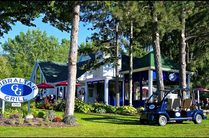 Gibraltar Grill outdoor building and golf cart in Fish Creek Wi