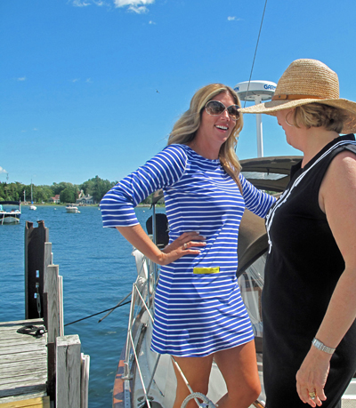 Girls with coverups on boat cropped REview